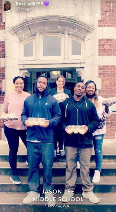 Zyion Houston-Sconiers, in front at right, and his co-defendant in the 2012 Halloween candy robbery, Treson Roberts, deliver cupcakes to Jason Lee Middle School in Tacoma, Washington, in 2018. (Photo courtesy of Arrogrance Wood-Houston)