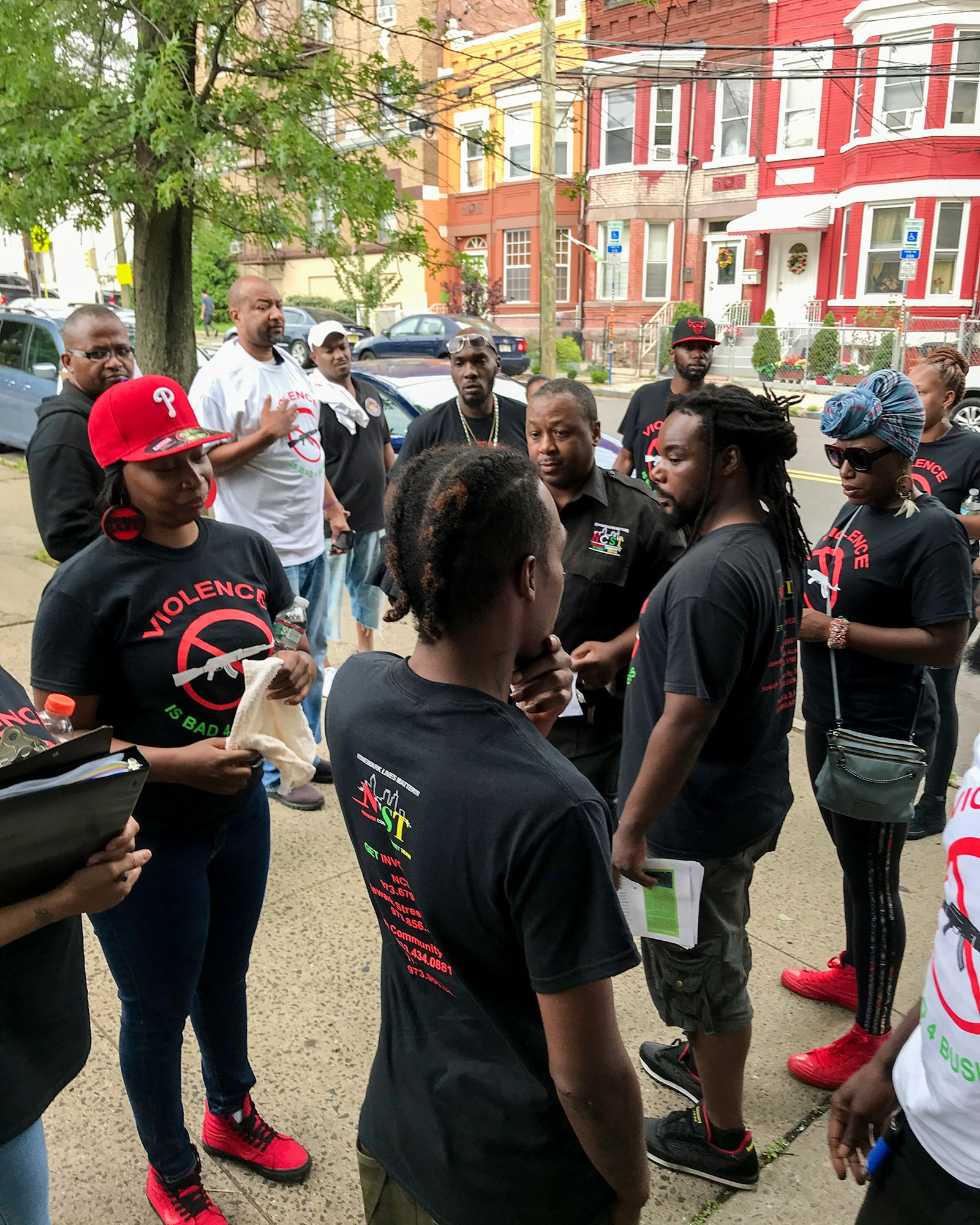 """The Newark Community Street Team was created in 2015 after a three-year federal investigation found that Newark's police had a history of unconstitutional conduct that """"eroded public confidence in the police."""" (Photo courtesy of Aqeela Sherrills)"""